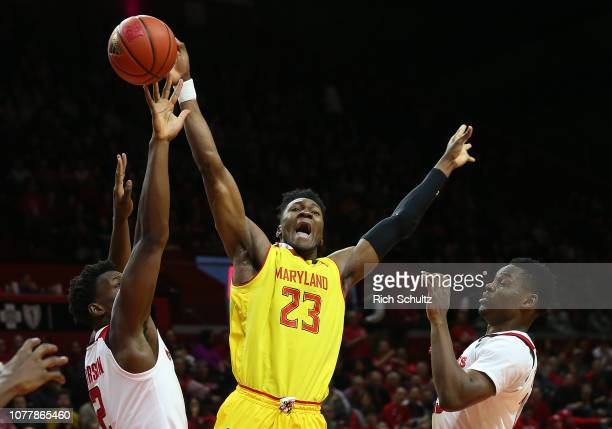Bruno Fernando of the Maryland Terrapins fights for a rebound between Shaquille Doorson and Montez Mathis of the Rutgers Scarlet Knights during the...