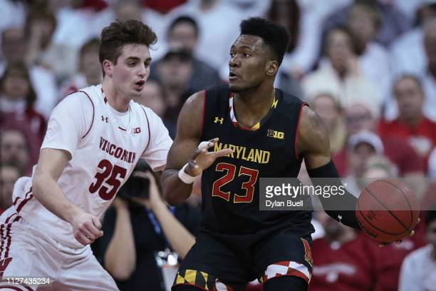 Bruno Fernando of the Maryland Terrapins handles the ball while being guarded by Nate Reuvers of the Wisconsin Badgers in the first half at the Kohl...
