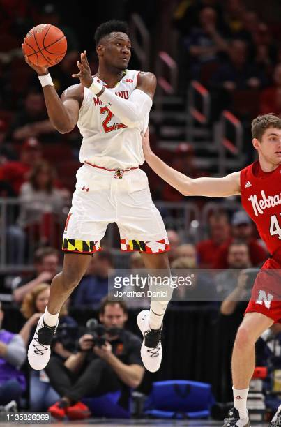 Bruno Fernando of the Maryland Terrapins leaps to pass over Brady Heiman of the Nebraska Cornhuskers at the United Center on March 14 2019 in Chicago...