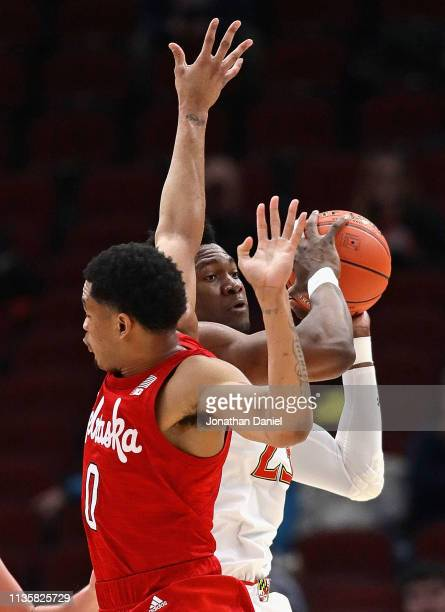 Bruno Fernando of the Maryland Terrapins tries to pass against James Palmer Jr #0 of the Nebraska Cornhuskers at the United Center on March 14 2019...
