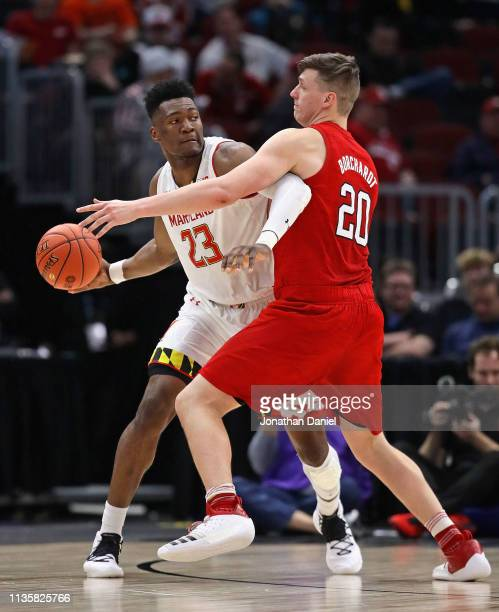 Bruno Fernando of the Maryland Terrapins tries to pass against Tanner Borchardt of the Nebraska Cornhuskers at the United Center on March 14 2019 in...