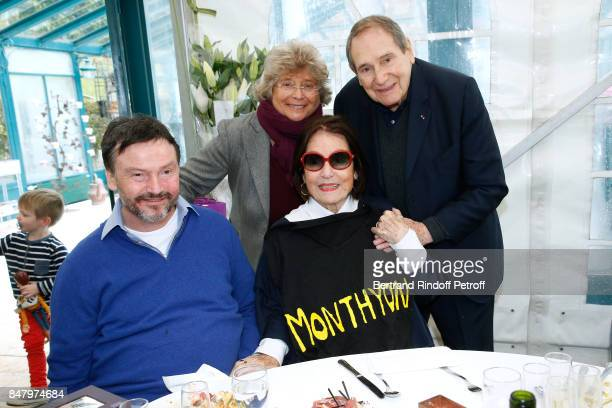 Bruno Finck, Jacqueline Franjoux, Nana Mouskouri and Robert Hossein attend the Garden Party organized by Bruno Finck, companion of Jean-Claude...