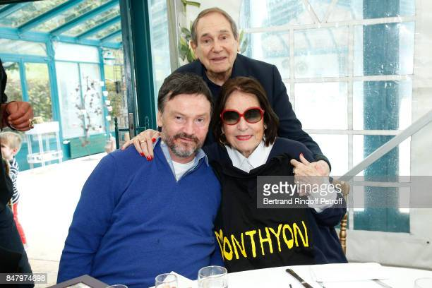 Bruno Finck Robert Hossein and Nana Mouskouri attend the Garden Party organized by Bruno Finck companion of JeanClaude Brialy at Chateau De Monthyon...