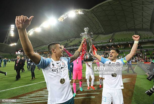 Bruno Fornaroli and Tim Cahill of Melbourne City celebrate after Melbourne City defeated Sydney FC during the FFA Cup Final match between Melbourne...