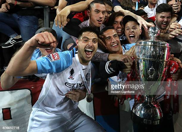 Bruno Fornaroli and Tim Cahill of Melbourne City celebrate with fans after Melbourne City defeated Sydney FC during the FFA Cup Final match between...