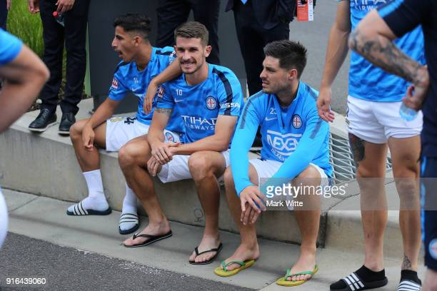 Bruno Fornaroli Daniel Arzani and Dario Vidoic sit on the kerb during a evacuation before the round 20 ALeague match between Melbourne City and...