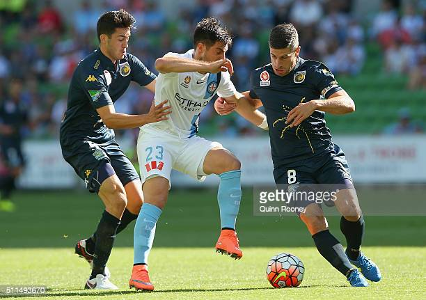 Bruno Fornaroli of City is tackled by Harry Ascroft and Nick Montgomery of the Mariners during the round 20 ALeague match between Melbourne City FC...