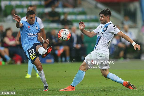 Bruno Fornaroli of Melbourne City and Ali Abbas of Sydney FC compete for the ball during the round 22 ALeague match between Melbourne City FC and...