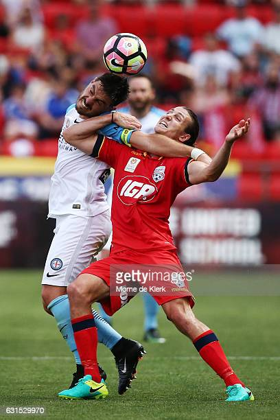 Bruno Fornaroli of Melbourne City competes with Michael Marrone of Adelaide United during the round 15 ALeague match between Adelaide United and...