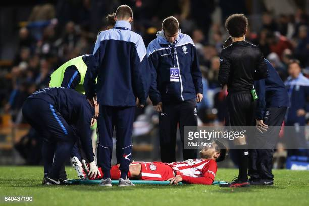 Bruno Fornaroli of Melbourne City is assisted onto a stretcher after sustaining an injury during the FFA Cup round of 16 match between Hakoah Sydney...