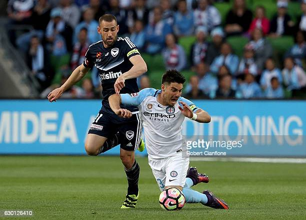 Bruno Fornaroli of Melbourne City is is challenged by Carl Valeri of the Victory during the round 11 ALeague match between Melbourne City FC and...