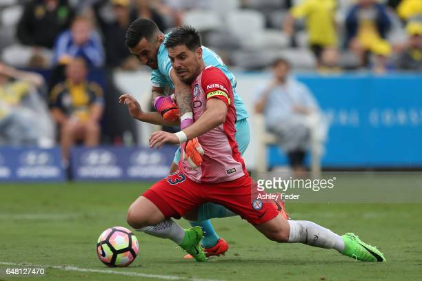 Bruno Fornaroli of Melbourne City is tackled by Paul Izzo of the Mariners during the round 22 ALeague match between the Central Coast Mariners and...