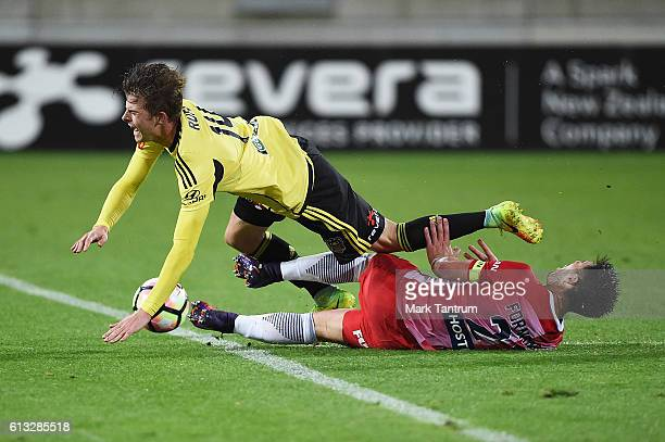 Bruno Fornaroli of Melbourne City tackles Alex Rufer of the Wellington Phoenix during the round one ALeague match between the Wellington Phoenix and...