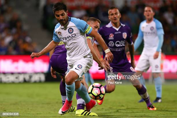Bruno Fornaroli of Melbourne controls the ball against Rostyn Griffiths of the Glory during the round 27 ALeague match between the Perth Glory and...
