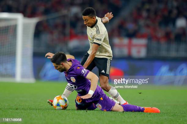 Bruno Fornaroli of Perth Glory and Jesse Lingard of Manchester United battle for the ball during the match between the Perth Glory and Manchester...