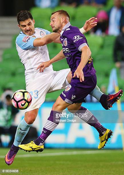 Bruno Fornaroli of the City and Marc Warren of the Glory compete for the ball during the round three ALeague match between Melbourne City FC and...