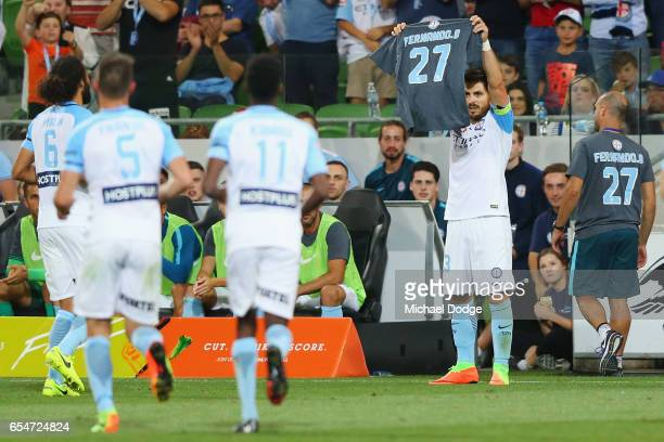 Bruno Fornaroli of the City celebrates a penalty goal and then holds up the shirt of Fernando Brandan of the City during the round 23 ALeague match...