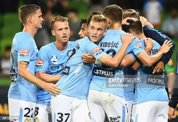 Bruno Fornaroli of the City is congratulated by team mates after scoring a goal during the round 24 ALeague match between Melbourne City and the...