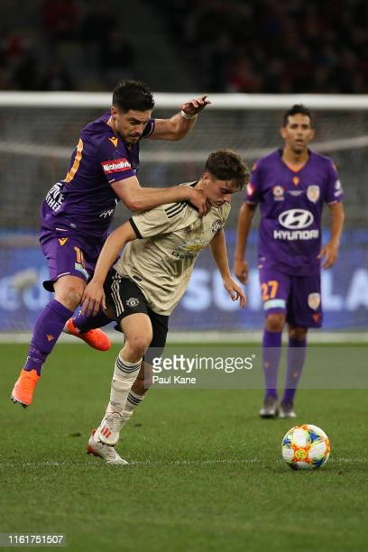 Bruno Fornaroli of the Glory and Daniel James of Manchester United contest for the ball during the match between the Perth Glory and Manchester...
