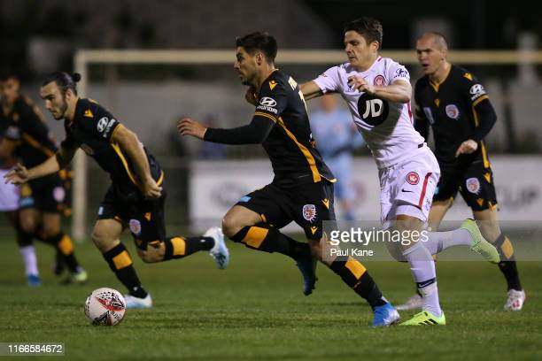 Bruno Fornaroli of the Glory is fouled by Pirmin Schwegler of the Wanderers during the FFA Cup Round of 32 match between Perth Glory and the Western...