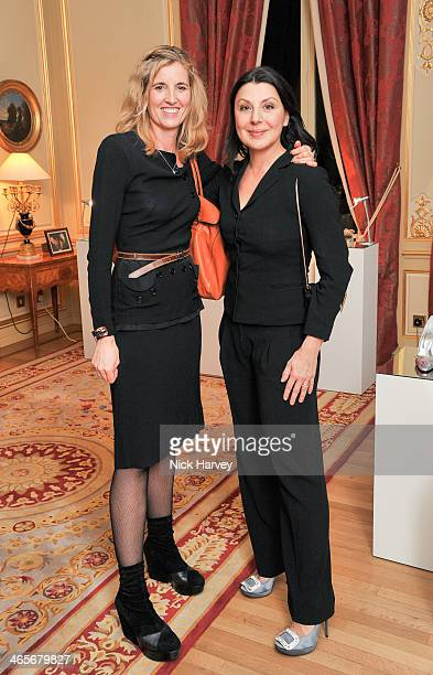Bruno Frisoni and Allegra Donn attend an evening to celebrate the Roger Vivier RendezVous SpringSummer 2013 limited edition collection on January 28...