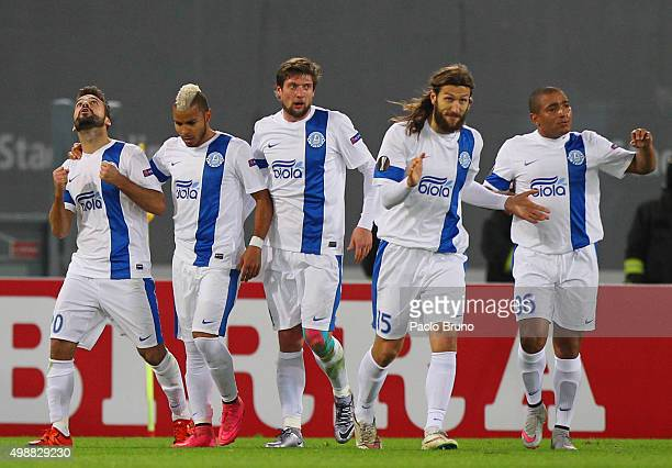 Bruno Gama with his teammates of FC Dnipro Dnipropetrovsk celebrates after scoring the team's first goal during the UEFA Europa League group G match...