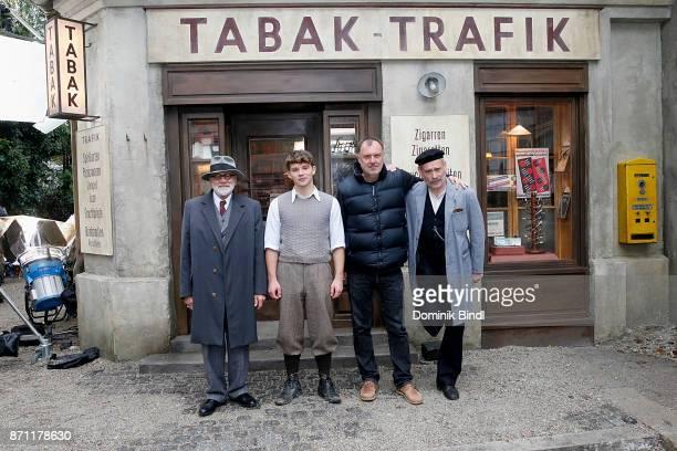 Bruno Ganz Simon Morzé Nikolaus Leytner and Johannes Krisch pose during a set visit of the film production 'Der Trafikant' at Bavaria Studios on...