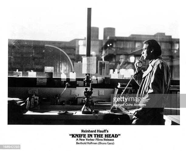 Bruno Ganz talks on the phone in a scene from the film 'Knife In The Head' 1978