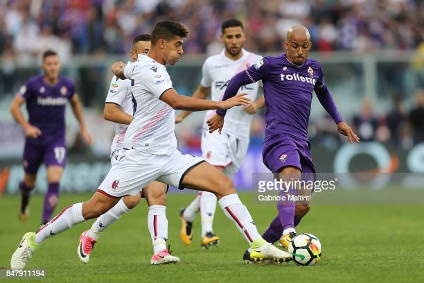 Bruno Gaspar of ACF Fiorentina battles for the ball with Adam Masina of Bologna FC during the Serie A match between ACF Fiorentina and Bologna FC at...