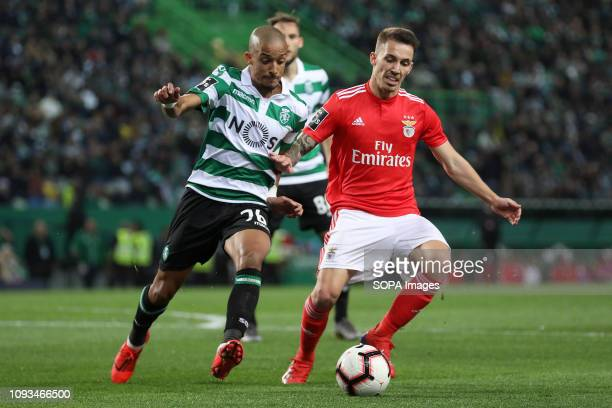 Bruno Gaspar of Sporting CP vies for the ball with Álex Grimaldo of SL Benfica during the League NOS 2018/19 footballl match between Sporting CP vs...