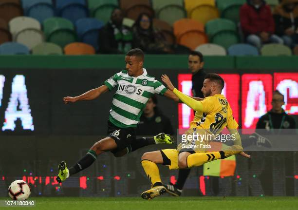 Bruno Gaspar of Sporting CP with Vitor Goncalves of CD Nacional in action during the Liga NOS match between Sporting CP and CD Nacional at Estadio...