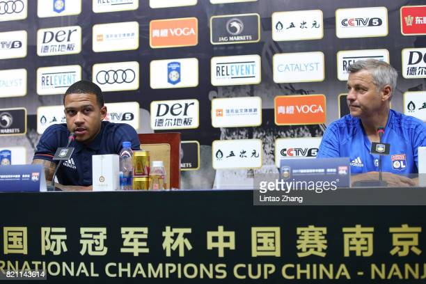 Bruno Genesio head coach of Lyon with player Memphis Depay attends the a press conference ahead of the 2017 International Champions Cup football...