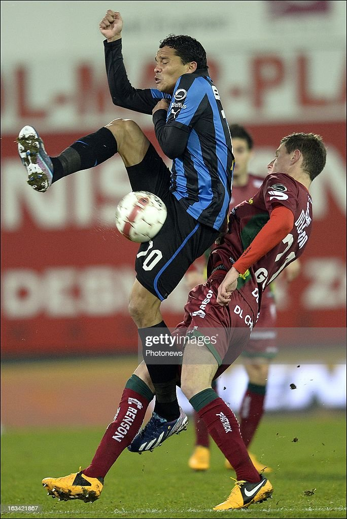 Bruno Godeau of Zulte-Waregem battles for the ball with Carlos Bacca of Club Brugge KV during the Jupiler League match between SV Zulte Waregem and Club Brugge KV on March 9, 2013 in Waregem, Belgium.
