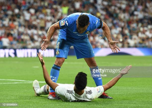 Bruno Gonzalez of Getafe argues with Marco Asensio of Real Madrid after Asensio called for a penalty kick during the La Liga match between Real...