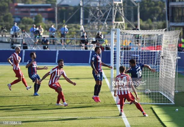 Bruno Gonzalez of Levante scores an own goal as Marcos Llorente and Diego Costa celebrate during the Liga match between Levante UD and Club Atletico...
