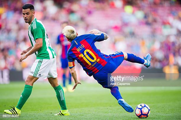 Bruno Gonzalez of Real Betis Balompie fouls Lionel Messi of FC Barcelona during the La Liga match between FC Barcelona and Real Betis Balompie at...