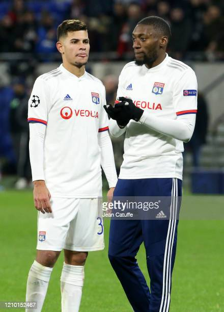 Bruno Guimaraes Karl Toko Ekambi of Lyon celebrate the victory with the supporters following the UEFA Champions League round of 16 first leg match...