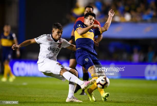 Bruno Guimaraes of Atletico Paranaense fights for the ball with Nicolas Capaldo of Boca Juniors during a round of sixteen second leg match between...