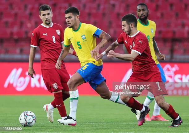 Bruno Guimaraes of Brazil in action against Dejan Tetek of Serbia during the International football friendly match between Serbia U21 and Brazil U23...