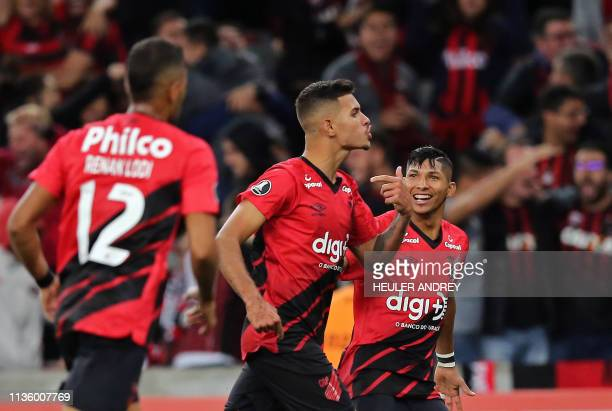Bruno Guimaraes of Brazil's Athletico Paranaense celebrates his goal against Colombia's Deportes Tolima with Rony during the 2019 Copa Libertadores...