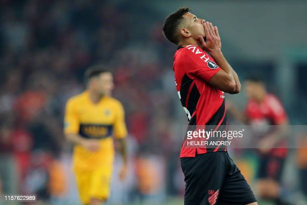 Bruno Guimaraes of Brazil's Athletico Paranaense reacts after missing a chance to score during a Copa Libertadores football match between Brazil's...