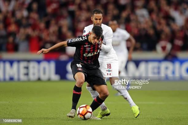 Bruno Guimaraes of Brazils Atletico Paranaense vies for the ball with Everaldo of Brazil's Fluminense during their 2018 Copa Sudamericana first leg...
