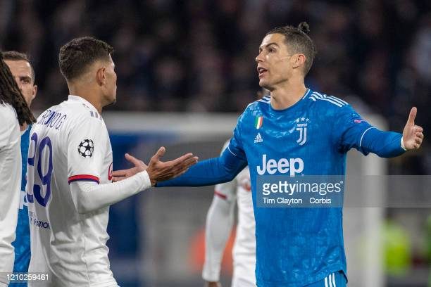Bruno Guimaraes of Lyon and Cristiano Ronaldo of Juventus react to a refereeing decision during the Lyon V Juventus UEFA Champions League Round of...