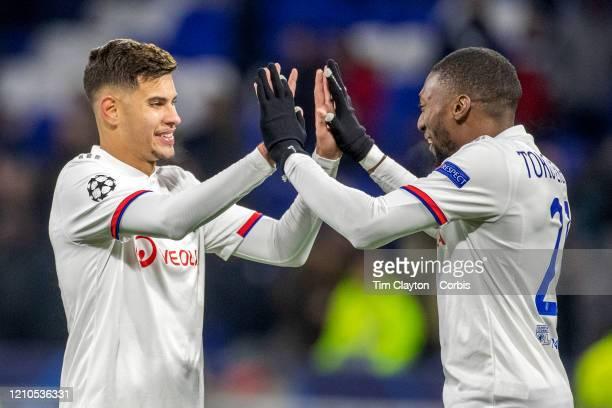 Bruno Guimaraes of Lyon and Karl Toko Ekambi of Lyon celebrate the teams victory at the end of the game during the Lyon V Juventus UEFA Champions...