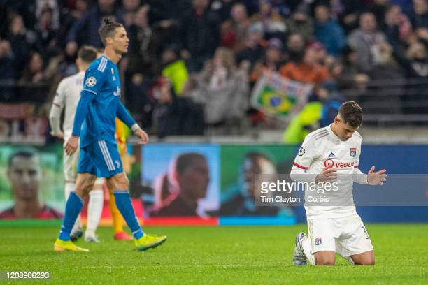 Bruno Guimaraes of Lyon celebrates his sides victory as Cristiano Ronaldo of Juventus leaves the field during the Lyon V Juventus UEFA Champions...
