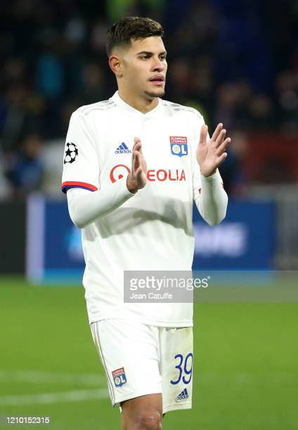 Bruno Guimaraes of Lyon celebrates the victory with the supporters following the UEFA Champions League round of 16 first leg match between Olympique...