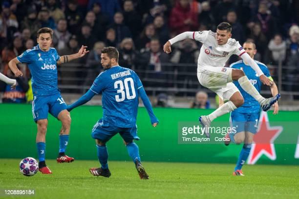 Bruno Guimaraes of Lyon challenged Rodrigo Bentancur of Juventus during the Lyon V Juventus UEFA Champions League Round of Sixteen 1st leg match at...