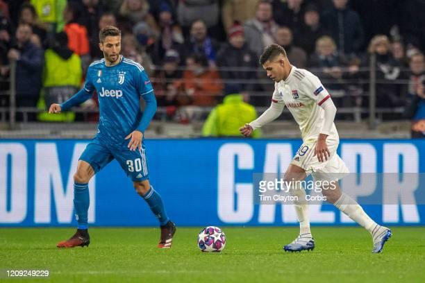 Bruno Guimaraes of Lyon makes a pass watched by Rodrigo Bentancur of Juventus during the Lyon V Juventus UEFA Champions League Round of Sixteen 1st...