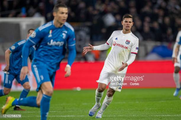 Bruno Guimaraes of Lyon watches Cristiano Ronaldo of Juventus during the Lyon V Juventus UEFA Champions League Round of Sixteen 1st leg match at...