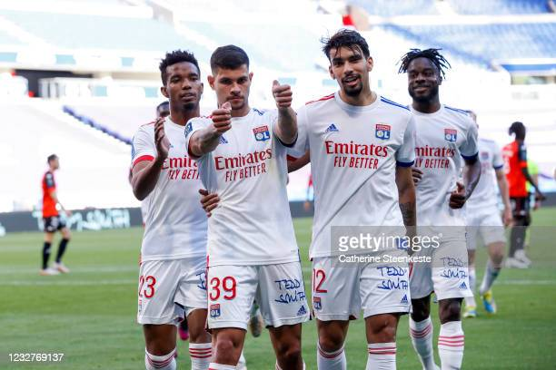 Bruno Guimaraes of Olympique Lyonnais celebrates his goal with Lucas Paqueta and his teammates of Olympique Lyonnais during the Ligue 1 match between...